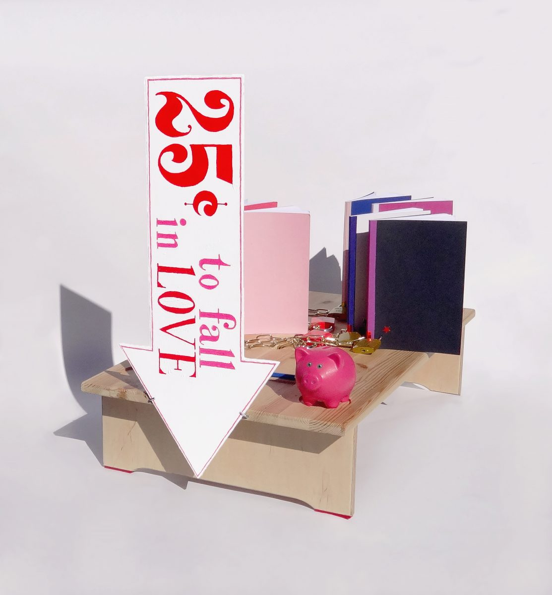 25 Cents to Fall in Love 2018 - Ongoing / Performance, installation + object: Wood, engraved steel locks, handmade books, brass-covered steel chains, piggy bank, felt, acrylic paint, candy